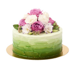 Single tier white and green wedding cake with flowers on top