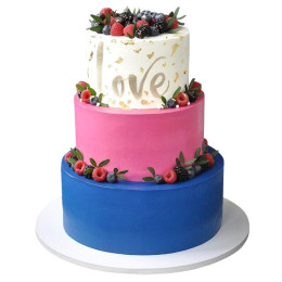 Wedding cake in three tiers with the inscription Love and fresh berries