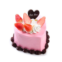 A celebratory cake in the shape of a heart with fresh strawberries and cream