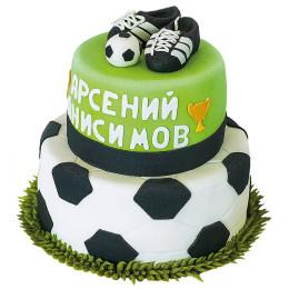 Детский торт в два яруса с фигуркой бутс и мячом