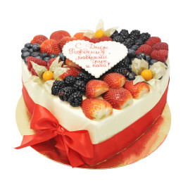 Birthday cake in one tier in the shape of a heart of strawberries, raspberries, blueberries and physalis