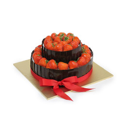Cake festive in two tiers decorated with fresh strawberries