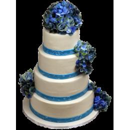 Белый свадебный  торт в четыре этажа украшеный цветами сиреневого цвета