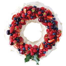Cake for the New Year in the form of a wreath with berries