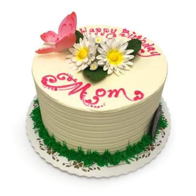Торт на 8 марта одноярусный белого цвета украшен цветами из мастики