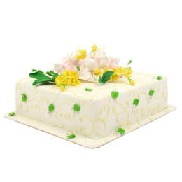 Торт праздничный в один ярус с желтыми и розовыми цветами