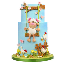 Children's cake with lamb applique on a swing